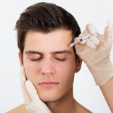 Botox being injected to eye area